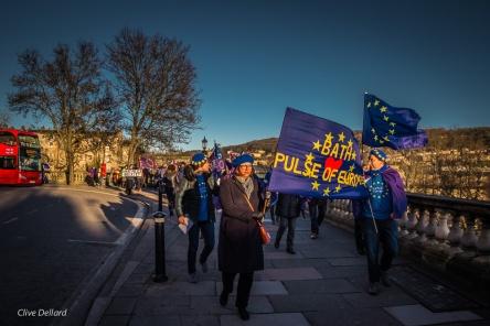 Low winter sun shines on marchers. Photo © Clive Dellard